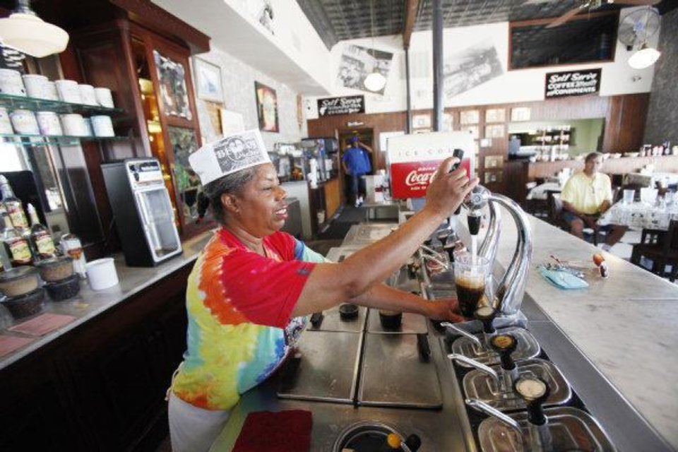 Photo - Ola Hall makes a root beer float at the Grateful Bean in Oklahoma City, Oklahoma July 15 , 2010. The Grateful Bean is closing after 18 years of business. Photo by Steve Gooch, The Oklahoman ORG XMIT: KOD