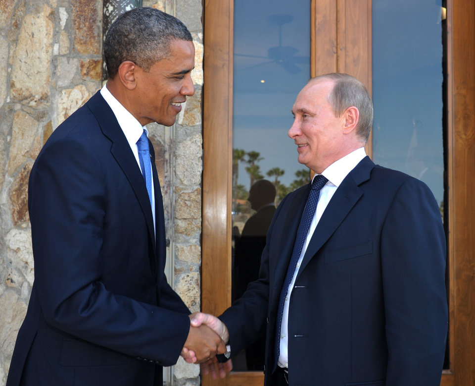 Photo -   U.S. President Barack Obama, left, greets Russia's President Vladimir Putin at the G-20 Summit in Los Cabos, Mexico, Monday, June 18, 2012. President Barack Obama and Russian President Vladimir Putin huddle on the sidelines of the G-20 meeting in Mexico, in what officials say will be a candid, get-down-to-business meeting about their mutual interests and disagreements. It's their first meeting since Putin returned to Russia's top job. (AP Photo/RIA-Novosti, Alexei Nikolsky, Presidential Press Service)