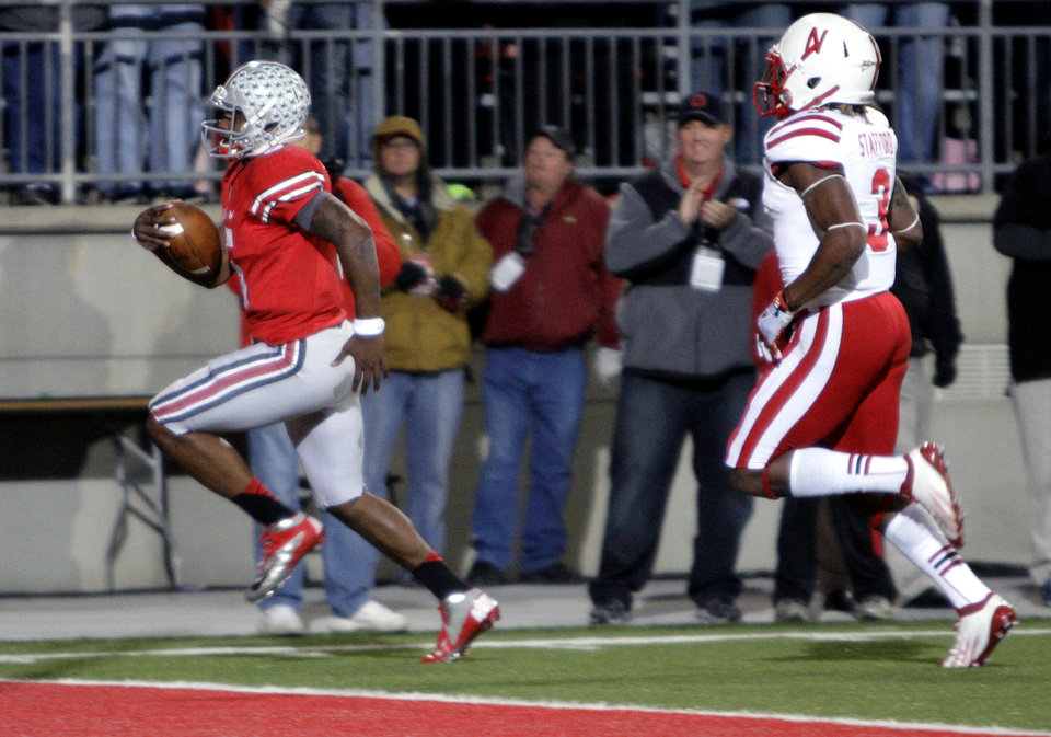 Ohio State quarterback Braxton Miller, left, scores a touchdown against Nebraska safety Daimion Stafford during the second quarter of an NCAA college football game, Saturday, Oct. 6, 2012, in Columbus, Ohio. (AP Photo/Jay LaPrete)