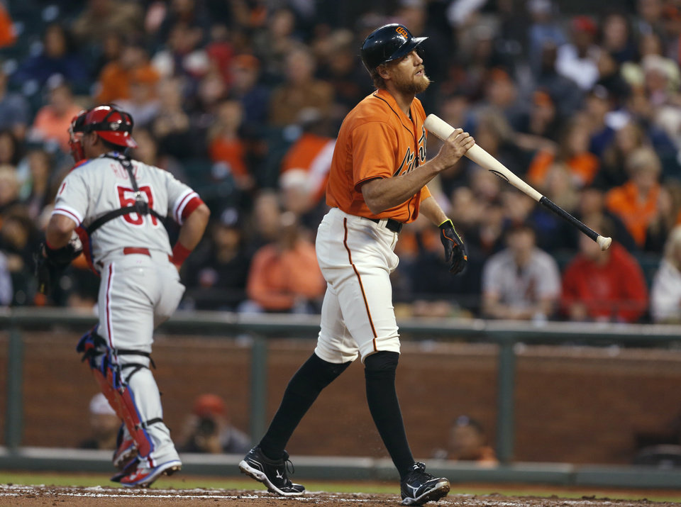 Photo - San Francisco Giants' Hunter Pence reacts after striking out to end the third inning of a baseball game against the Philadelphia Phillies, Friday, Aug. 15, 2014, in San Francisco. (AP Photo/Beck Diefenbach)