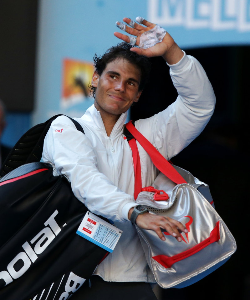 Photo - Rafael Nadal of Spain walks off the court after defeating Grigor Dimitrov of Bulgaria in their quarterfinal at the Australian Open tennis championship in Melbourne, Australia, Wednesday, Jan. 22, 2014.(AP Photo/Aaron Favila)
