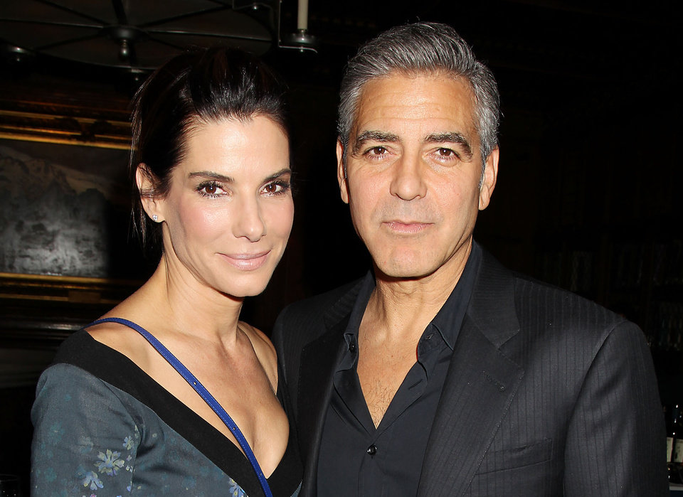 "Photo - This image released by Starpix shows Sandra Bullock, left, and George Clooney at luncheon honoring the film ""Gravity,"" and hosted by The Peggy Siegal Company and Warner Brothers Pictures at The Explorers Club, Wednesday, Oct. 2, 2013 in New York. (AP Photo/Starpix, Dave Allocca) -PICTURED: Sandra Bullock and George Clooney    -PHOTO by: Dave Allocca/Startraksphoto.com -File name: DA560447.JPG -Location: The Explorers Club Editorial - Rights Managed Image - Please contact www.startraksphoto.com for licensing fee Startraks Photo New York, NY For licensing please call 212-414-9464 or email sales@startraksphoto.com ORG XMIT: NYET317"