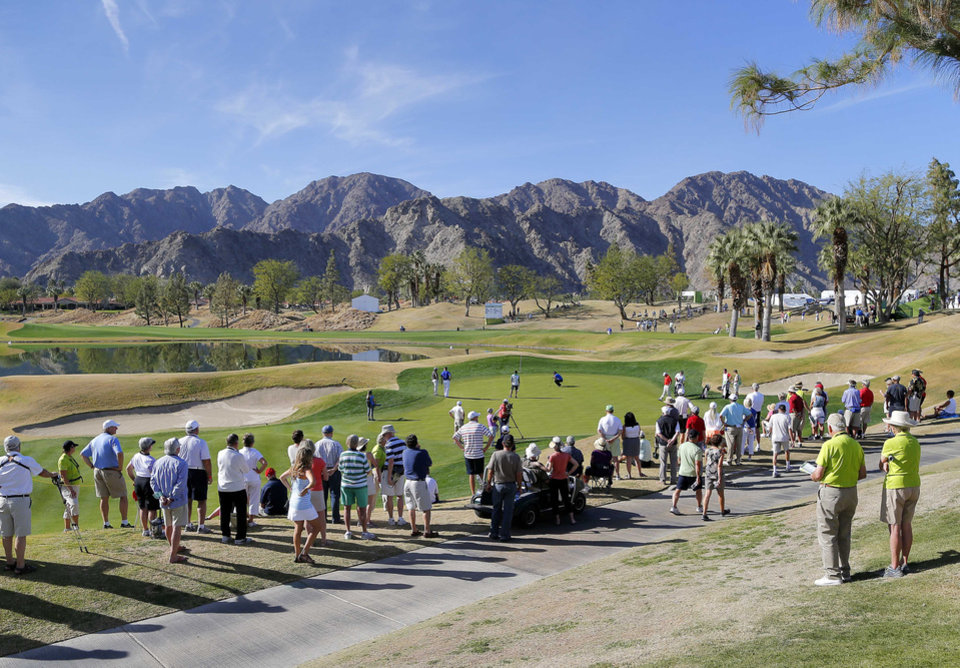 Photo - The gallery lines up to watch Patrick Reed on the ninth tee during the third round of the Humana Challenge PGA golf tournament on the Nicklaus Private course at PGA West, Saturday, Jan. 18, 2014, in La Quinta, Calif. Reed shot 9-under par for the third day in a row and is 27-under par going into the final round.  (AP Photo/Matt York)