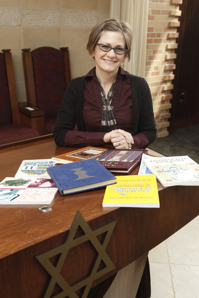 Rabbi Vered Harris prepares for the Jewish holiday of Passover with several of her personal Haggadoth at Temple B'nai Israel in Oklahoma City. A Haggadoth is a guide to the Passover Seder, the ceremonial meal traditionally held during the Jewish holiday. <strong>PAUL HELLSTERN - Oklahoman</strong>