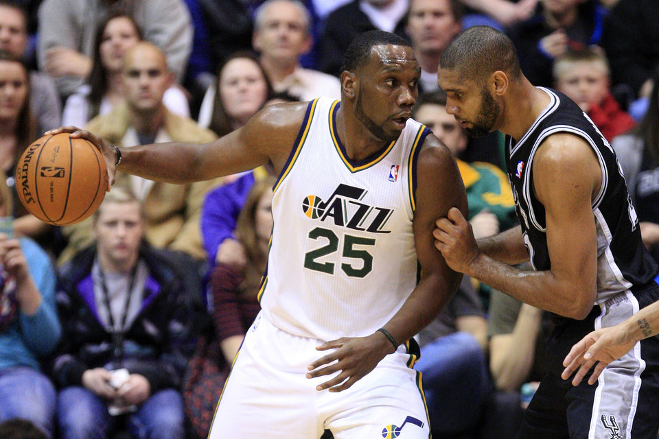San Antonio Spurs forward Tim Duncan, right, defends against Utah Jazz center Al Jefferson (25) in the first quarter during an NBA basketball game, Wednesday, Dec. 12, 2012, in Salt Lake City. (AP Photo/Rick Bowmer)