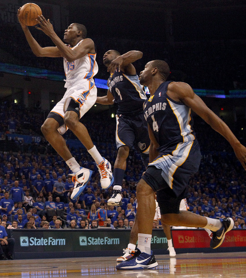 Oklahoma City's Kevin Durant (35) goes past Tony Allen (9) of and Sam Young (4) of Memphis Memphis during game two of the Western Conference semifinals between the Memphis Grizzlies and the Oklahoma City Thunder in the NBA basketball playoffs at Oklahoma City Arena in Oklahoma City, Tuesday, May 3, 2011. Photo by Bryan Terry, The Oklahoman
