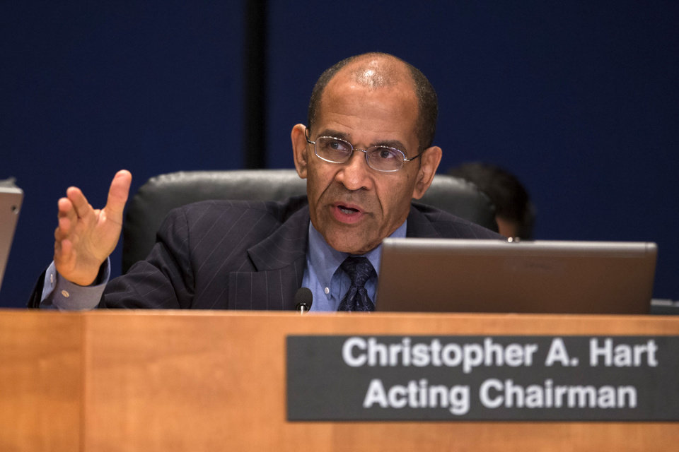 Photo - Acting National Transportation Safety Board (NTSB) Chairman Christopher Hart questions investigators during an NTSB hearing to establish the cause of the Asiana Flight 214 airlines crash in San Francisco,Tuesday, June 24, 2014, in Washington. Increasingly complex automated aircraft controls designed to improve safety are instead creating new opportunities for error, the head of the National Safety Board said Tuesday at a hearing on the crash last year of Asiana Flight 214 in San Francisco. (AP Photo/ Evan Vucci)