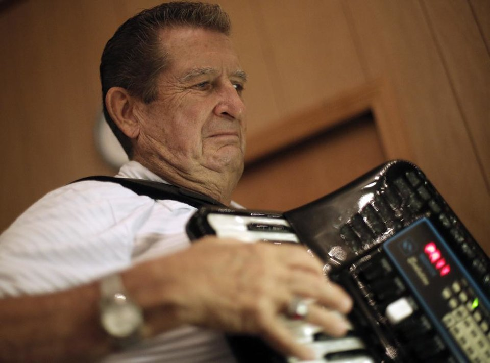 Photo -  Dick Albreski plays the accordion with the Milo Schedeck band at Czech Hall in Yukon, Okla., Saturday, Sept. 29, 2012.  Photo by Garett Fisbeck, The Oklahoman