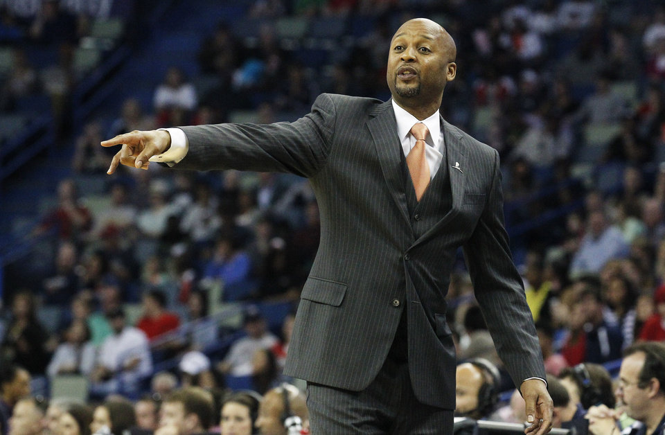 Photo - Denver Nuggets head coach Brian Shaw talks to his team in the first half of an NBA basketball game against the New Orleans Pelicans in New Orleans, Sunday, March 9, 2014. (AP Photo/Bill Haber)