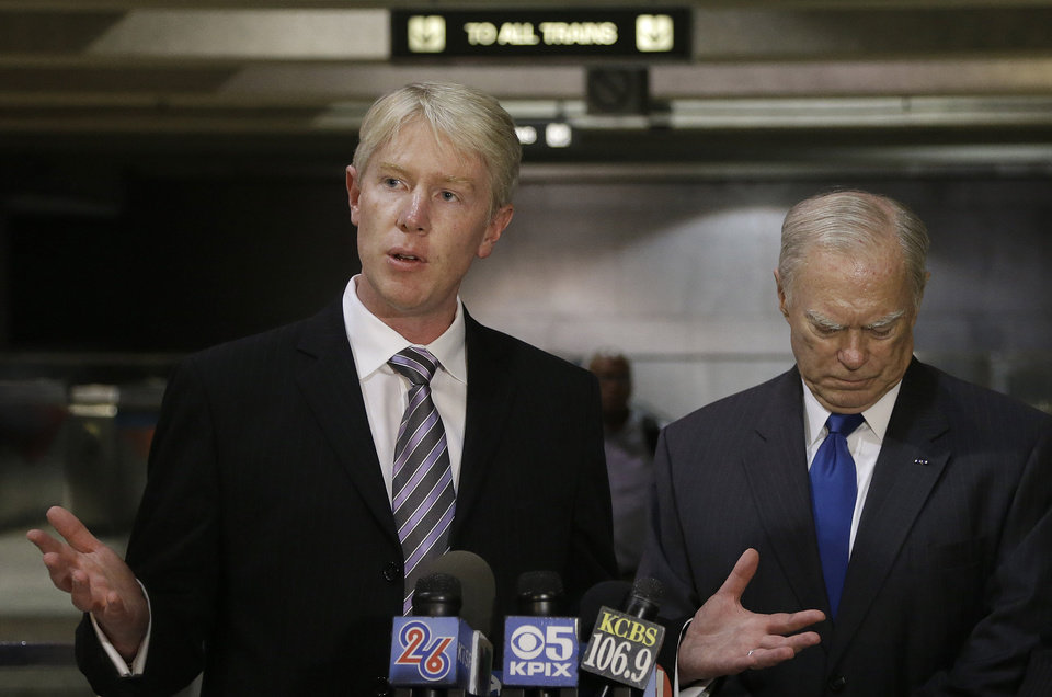 Photo - Richard Allen, director of the University of California, Berkeley, Seismological Lab, left, speaks next to John McPartland, Bay Area Rapid Transit System director, at a news conference in San Francisco, Monday, Aug. 25, 2014. Allen is among the researchers testing the earthquake early warning system envisioned as the basis for the state of California's system. (AP Photo/Jeff Chiu)
