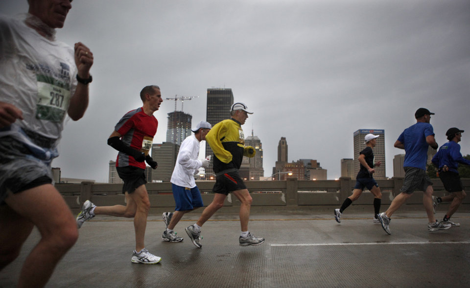 Photo - People run over the Dr. G. E. Finley Bridge during the Oklahoma City Memorial Marathon, Sunday, May 1, 2010, in Oklahoma City. Photo by Sarah Phipps, The Oklahoman