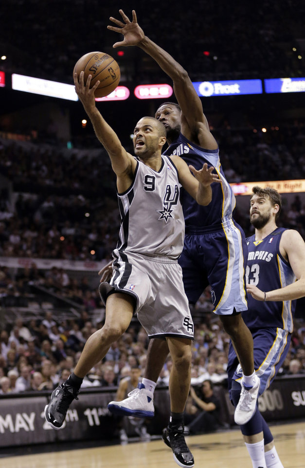 Photo - San Antonio Spurs' Tony Parker (9), of France, shoots as Memphis Grizzlies' Tony Allen, right, reached over to defend him during the first half in Game 1 of a Western Conference Finals NBA basketball playoff series, Sunday, May 19, 2013, in San Antonio. (AP Photo/Eric Gay)