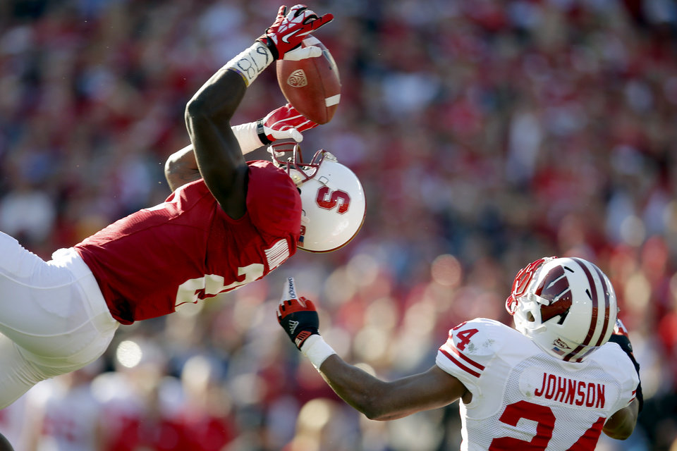 Stanford wide receiver Jamal-Rashad Patterson, left, makes a catch against Wisconsin defensive back Shelton Johnson (24) during the first half of the Rose Bowl NCAA college football game, Tuesday, Jan. 1, 2013, in Pasadena, Calif. (AP Photo/Jae C. Hong)