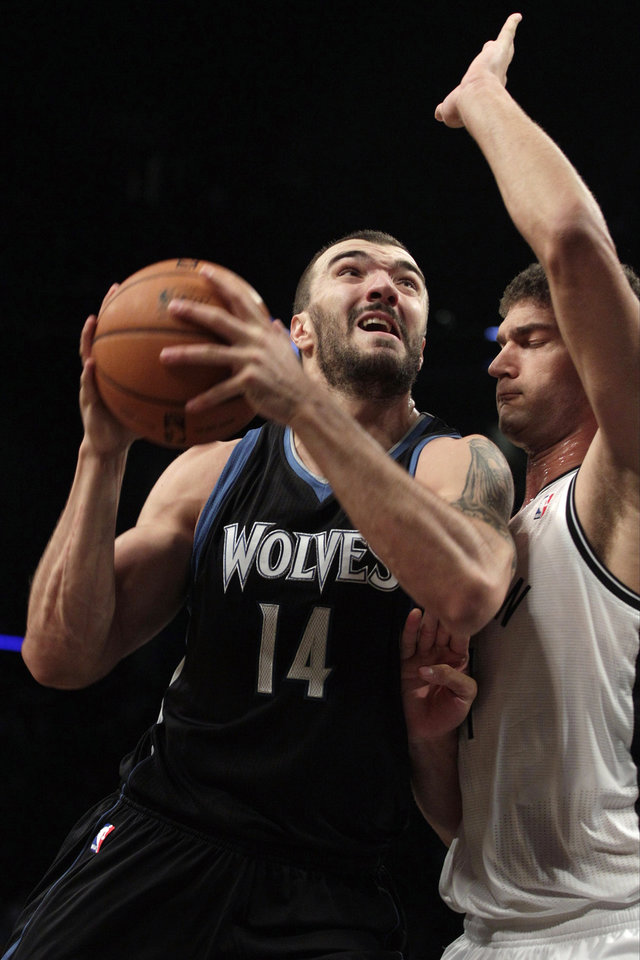 Minnesota Timberwolves\' Nikola Pekovic (14) shoots over Brooklyn Nets\' Brook Lopez (11) during the first half of an NBA basketball game, Monday, Nov. 5, 2012, in New York. (AP Photo/Frank Franklin II)