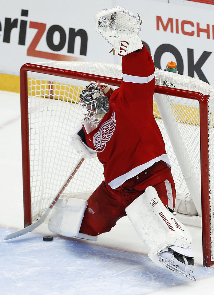 Photo - Detroit Red Wings goalie Jonas Gustavsson, of Sweden, stops a Chicago Blackhawks right wing Patrick Kane shot in a shootout during an NHL hockey game Wednesday, Jan. 22, 2014, in Detroit. Detroit won 5-4. (AP Photo/Paul Sancya)