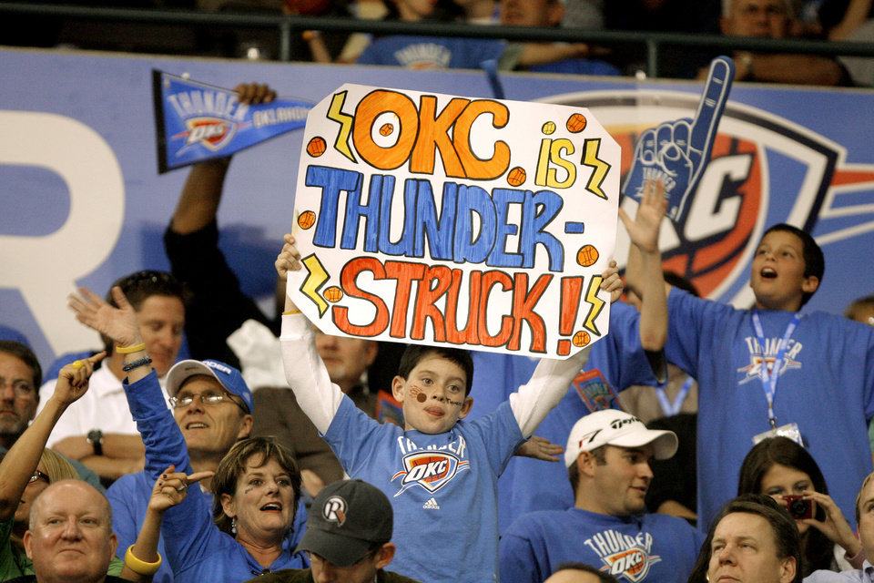 Fans cheer during the opening NBA basketball game between the Oklahoma City Thunder and the Milwaukee Bucks at the Ford Center in Oklahoma City, Wednesday, October 29, 2008.  BY BRYAN TERRY, THE OKLAHOMAN