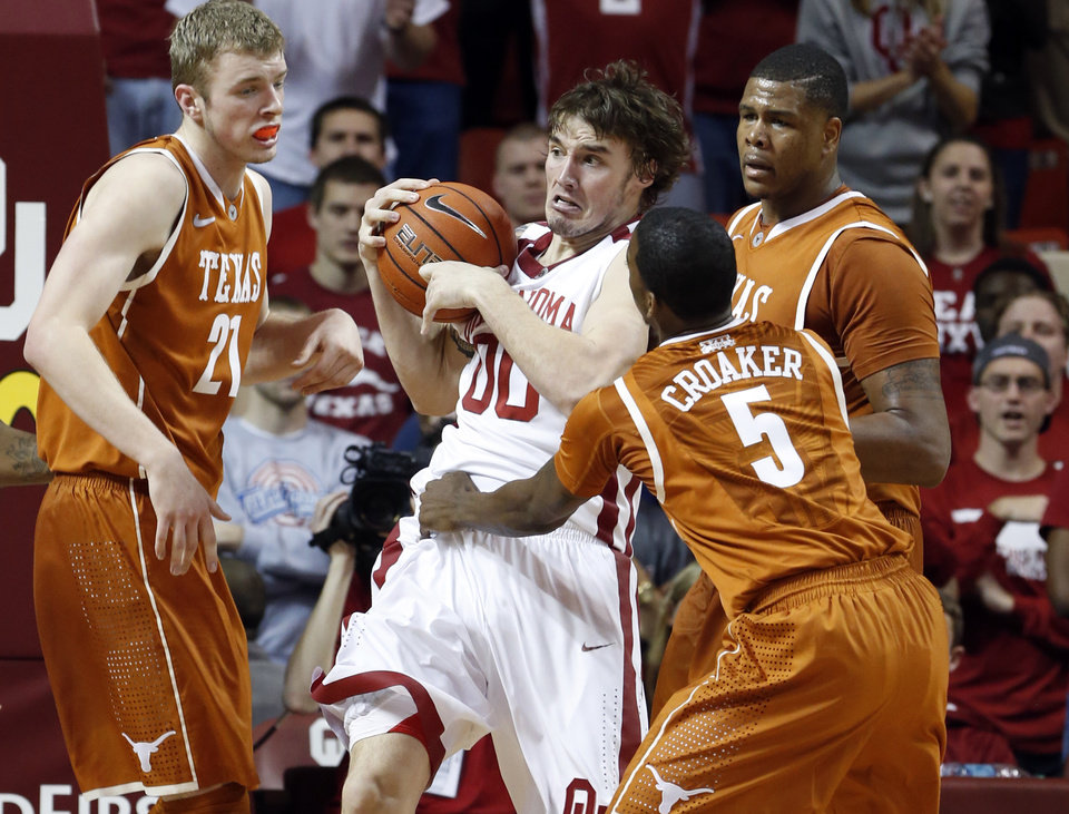 Photo - Oklahoma Sooner Ryan Spangler (00) rebounds between Texas Longhorn's Connor Lammert (21), Damarcus Croaker (5) and Cameron Ridley (55) in the second half as the University of Oklahoma Sooners (OU) men defeat the Texas Longhorns (TU) 77-65 in NCAA, college basketball at The Lloyd Noble Center on Saturday, March 1, 2014  in Norman, Okla. Photo by Steve Sisney, The Oklahoman