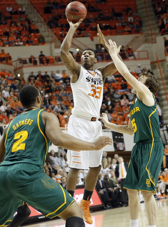 Oklahoma State 's Marcus Smart (33) shoots over Baylor's Rico Gathers (2) and Brady Heslip (5) during the college basketball game between the Oklahoma State University Cowboys (OSU) and the Baylor University Bears (BU) at Gallagher-Iba Arena on Wednesday, Feb. 5, 2013, in Stillwater, Okla. Photo by Chris Landsberger, The Oklahoman