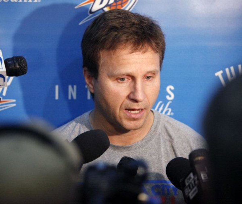 Photo - Thunder Head Coach Scott Brooks speaks to reporters during the Thunder's after practice media event at the Thunder practice facility in Oklahoma City, OK, Friday, May 20, 2011. By Paul Hellstern, The Oklahoman ORG XMIT: KOD  PAUL HELLSTERN