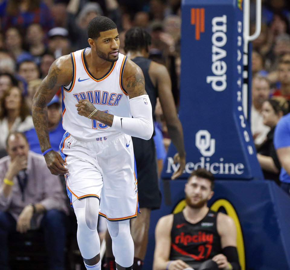 Photo - Oklahoma City's Paul George (13) runs back on defense after making a basket and leaving Portland's Jusuf Nurkic (27) on the court in the first quarter during an NBA basketball game between the Portland Trail Blazers and the Oklahoma City Thunder at Chesapeake Energy Arena in Oklahoma City, Monday, Feb. 11, 2019. Photo by Nate Billings, The Oklahoman