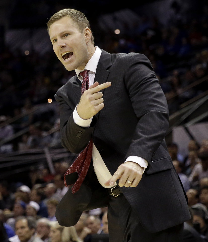 Photo - Iowa State coach Fred Hoiberg calls a play for his team during the first half of a third-round game against North Carolina in the NCAA college basketball tournament Sunday, March 23, 2014, in San Antonio. (AP Photo/David J. Phillip)