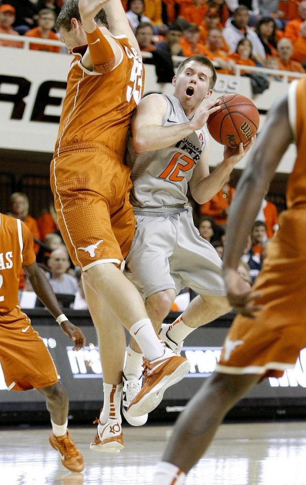 Photo - Oklahoma State's Keiton Page (12) is fouled by Texas' Clint Chapman (53) as he shoots during an NCAA college basketball game between Oklahoma State University (OSU) and the University of Texas (UT) at Gallagher-Iba Arena in Stillwater, Okla., Saturday, Feb. 18, 2012. Oklahoma State won 90-78. Photo by Bryan Terry, The Oklahoman