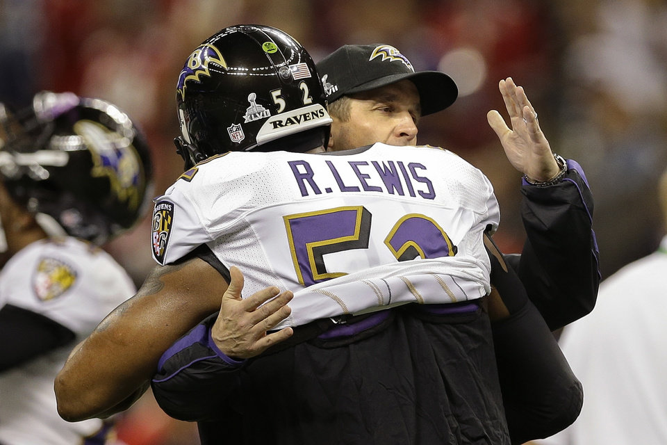 Baltimore Ravens head coach John Harbaugh hugs linebacker Ray Lewis (52) before playing the San Francisco 49ers in the NFL Super Bowl XLVII football game, Sunday, Feb. 3, 2013, in New Orleans. (AP Photo/Patrick Semansky)