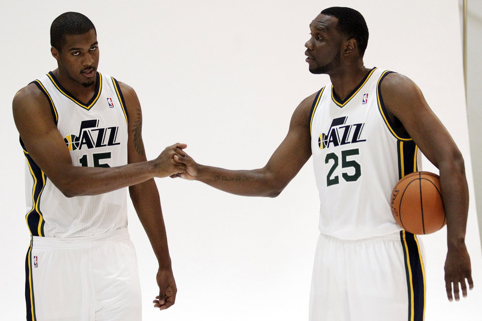 Photo -   Utah Jazz's Derrick Favors, left, and Al Jefferson pose for a photograph during their NBA basketball media day, Monday, Oct. 1, 2012, in Salt Lake City. (AP Photo/Rick Bowmer)
