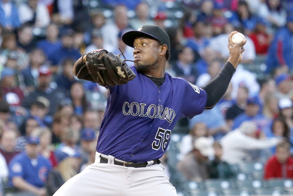 Photo - Colorado Rockies starting pitcher Yohan Flande delivers during the first inning of a baseball game against the Chicago Cubs Monday, July 28, 2014, in Chicago. (AP Photo/Charles Rex Arbogast)
