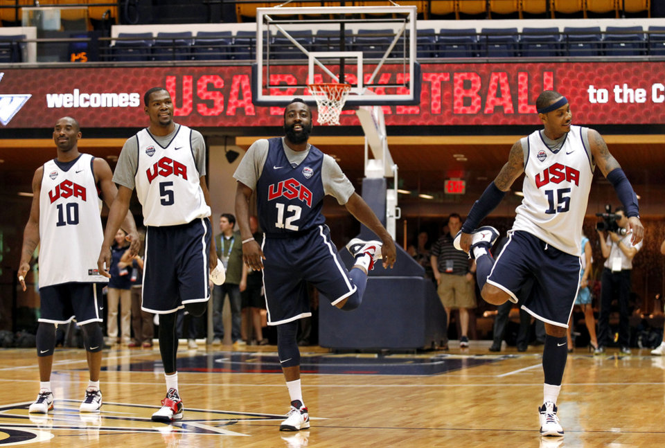 Photo -   U.S. men's Olympic basketball team members Kobe Bryant, Kevin Durant, James Harden, and Carmelo Anthony stretch during a practice Sunday, July 15, 2012, in Washington. (AP Photo/Alex Brandon)