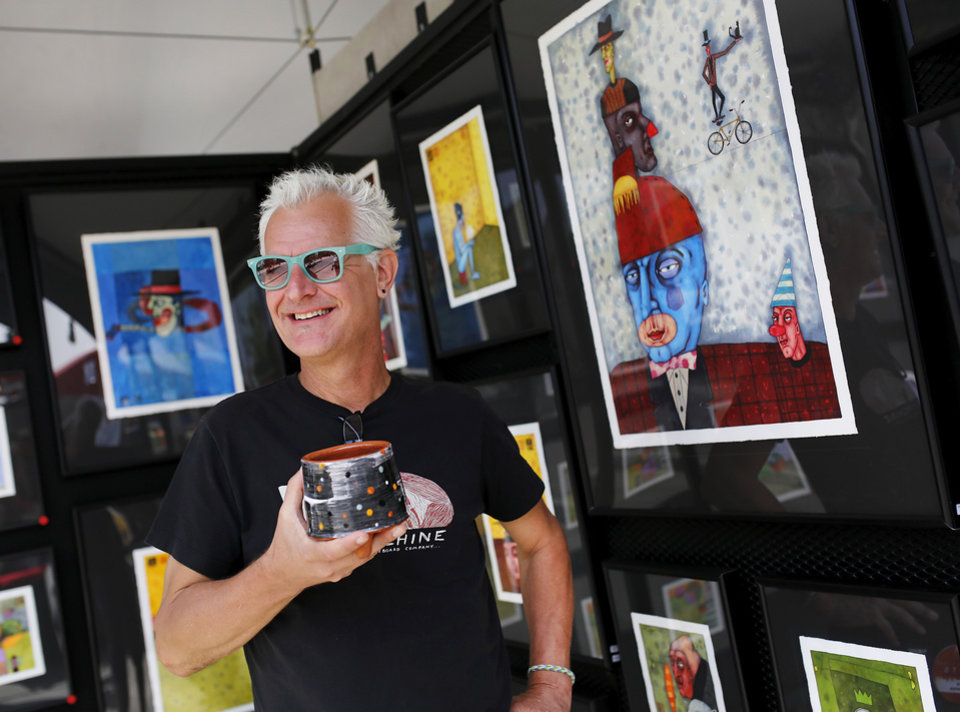 "Photo -  Oklahoma City artist Mike ""Kemper""with some of the colorful art displayed in his tent at at the 2014 Festival of the Arts in downtown Oklahoma City l on Wednesday. Photo by Jim Beckel, The Oklahoman   Jim Beckel -  THE OKLAHOMAN"