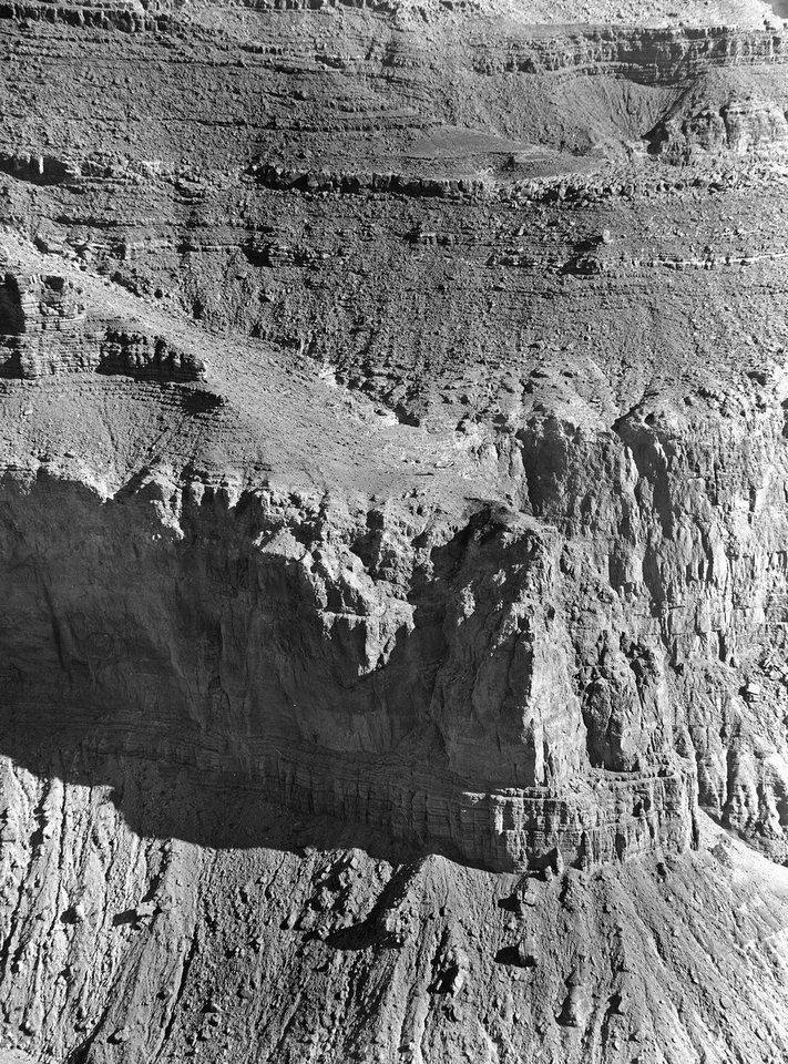 Photo - FILE - This July 5, 1956 file photo shows the view from across the Grand Canyon, where an Army helicopter was to drop one of the mountain climbers who was trying to reach the wreckage of a United Airline UAL DC-7 that crashed after colliding with a TWA Constellation. The crash spurred improvements to the air traffic control and radar systems, and led to the creation of the Federal Aviation Administration. On Tuesday, July 8, 2014, the Grand Canyon National Park will mark the designation of the crash site as a National Historic Landmark in a ceremony overlooking the gorge where the wreckage was scattered over 1.5 square miles. (AP Photo/David F. Smith, File)