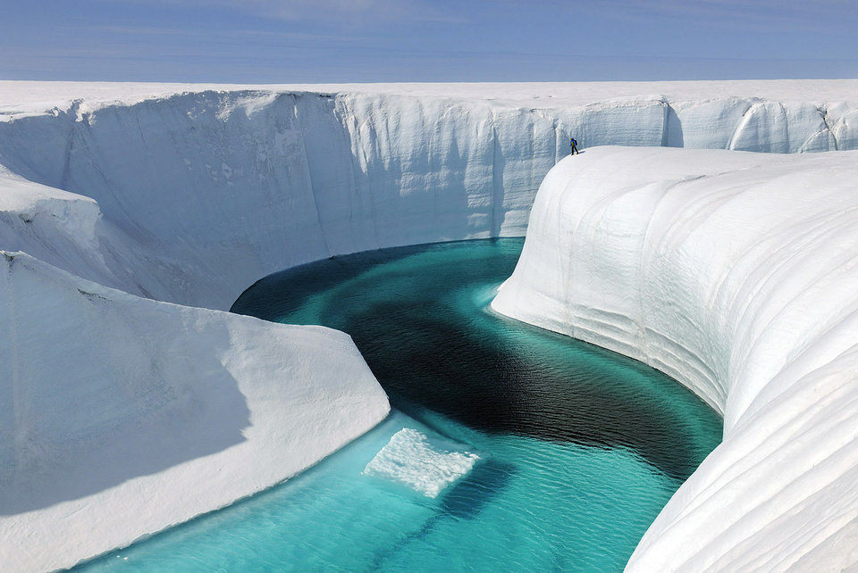 This 2009 photo released by Extreme Ice Survey shows Birthday Canyon in Greenland furing the filming of