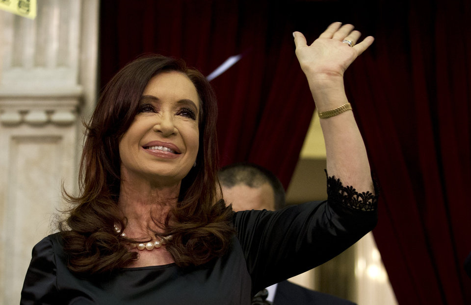 Argentina\'s President Cristina Fernandez waves to supporters after entering the chamber of the Argentine National Congress in Buenos Aires, Argentina, Friday, March 1, 2013. Fernandez was on hand to inaugurate the 2013 opening legislative session. (AP Photo/Victor R. Caivano)