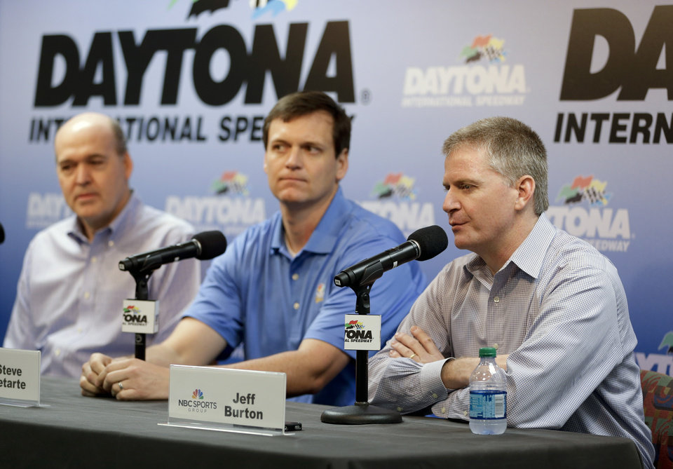 Photo - NASCAR driver Jeff Burton, right, speaks at a news conference with crew chief Steve Latarte, center, and Sam Flood, left,  Executive Producer at NBC Sports during Sprint Cup auto racing testing at Daytona International Speedway in Daytona Beach, Fla., Friday, Jan. 10, 2014. Latarte and Burton will join NBC Sports in 2015.(AP Photo/John Raoux)
