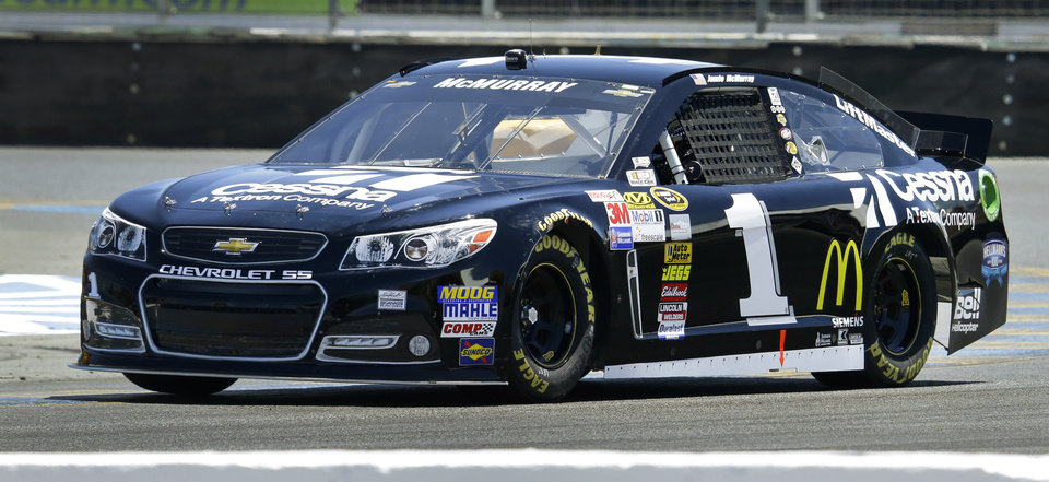 Photo - Jamie McMurray races during qualifying for the NASCAR Sprint Cup Series auto race Saturday, June 22, 2013, in Sonoma, Calif. McMyrray won the pole position for Sunday's race. (AP Photo/Ben Margot)