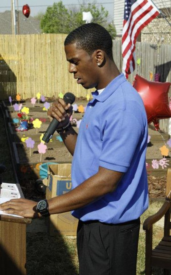 Photo - Julian Wilson, University of Oklahoma (OU) college football player, speaks at the dedication of Quinton Carter's charity educational garden at KinderCare on Friday, March 25, 2011, in Norman. Wilson is taking over at the KinderCare facility for former Sooner Quinton Carter. PHOTO BY STEVE SISNEY, The Oklahoman  STEVE SISNEY