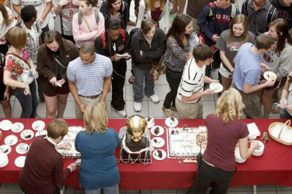 Students are served cake as the Edmond Memorial boys basketball team celebrates their State Championship during a ceremony at Edmond Memorial High School in Edmond, OK, Friday, March 25, 2011. By Paul Hellstern, The Oklahoman <strong>PAUL HELLSTERN</strong>