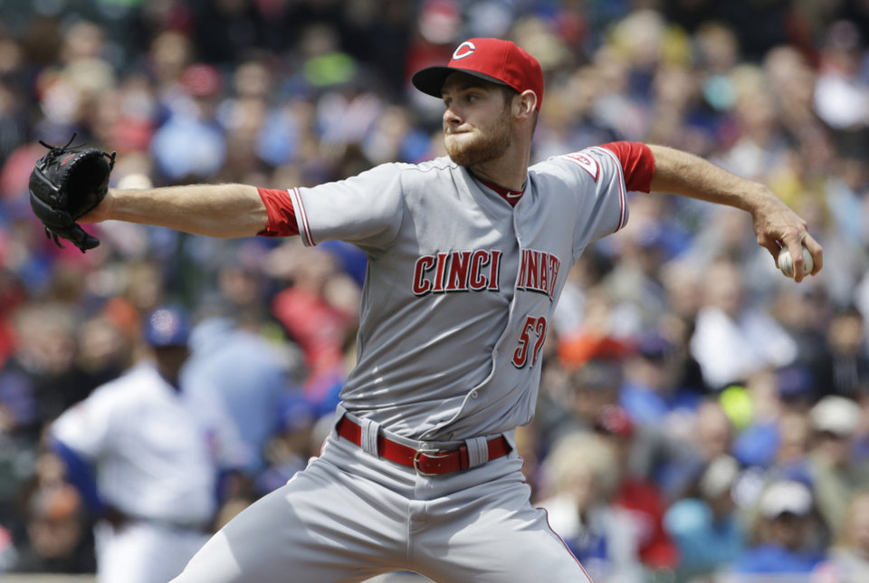 Photo - Cincinnati Reds starter Tony Cingrani throws against the Chicago Cubs during the first inning of a baseball game in Chicago, Saturday, April 19, 2014. (AP Photo/Nam Y. Huh)