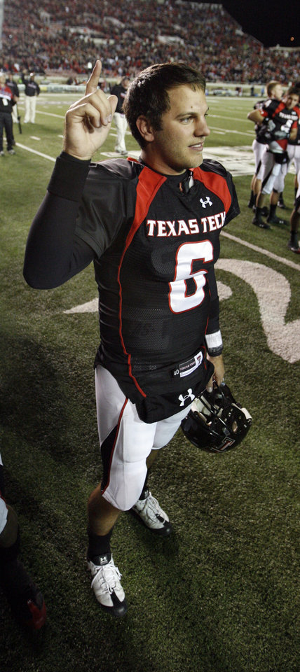 Photo - Graham Harrell salutes the fans after the college football game between the Oklahoma State University Cowboys (OSU) and the Texas Tech Red Raiders at Jones AT&T Stadium on Saturday, Nov. 8, 2008, in Lubbock, Tex.  Texas tech won 56-20.By Steve Sisney/The Oklahoman