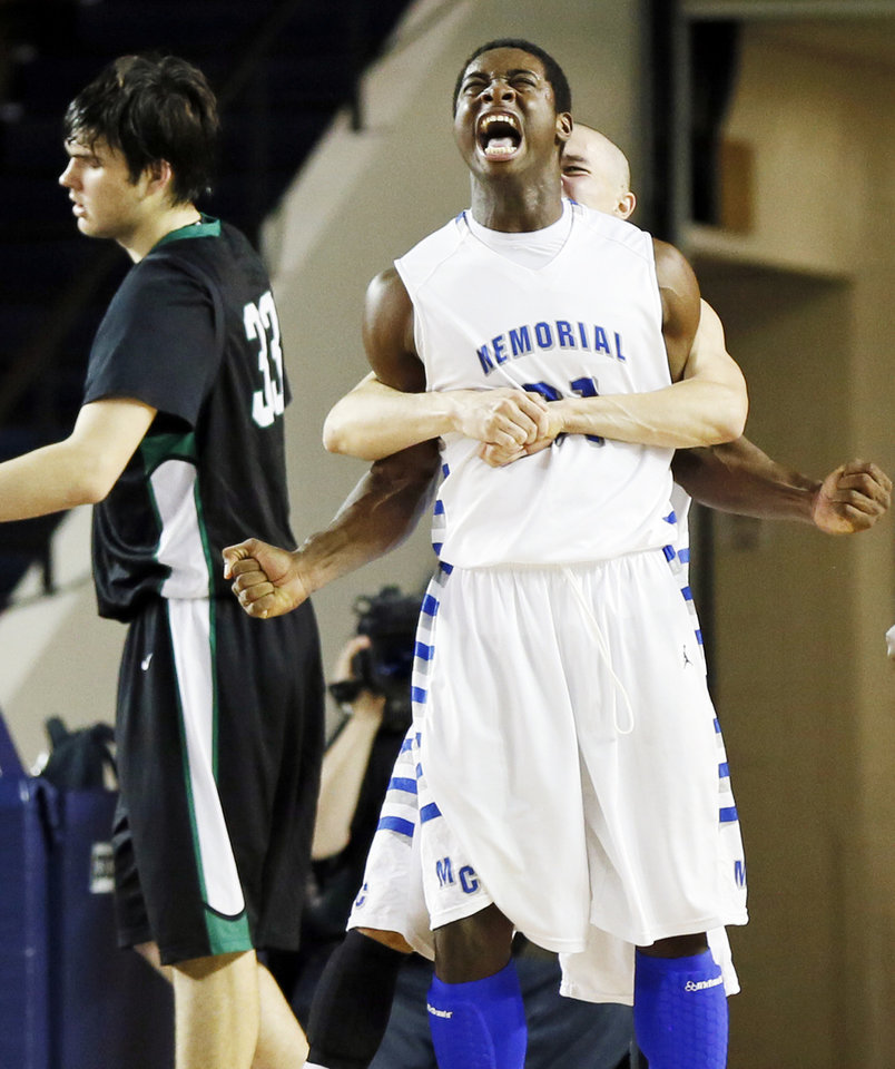 Tulsa Memorial\'s Mike\'Quan Deane (31) reacts as he is hugged by Devin Perez (20) after hitting a shot and being fouled by Bishop McGuinness\' Will Lienhard (33), left, during the Class 5A boys championship high school basketball game in the state tournament at the Mabee Center in Tulsa, Okla., Saturday, March 9, 2013. Tulsa Memorial defeated Bishop McGuinness, 59-42. Photo by Nate Billings, The Oklahoman