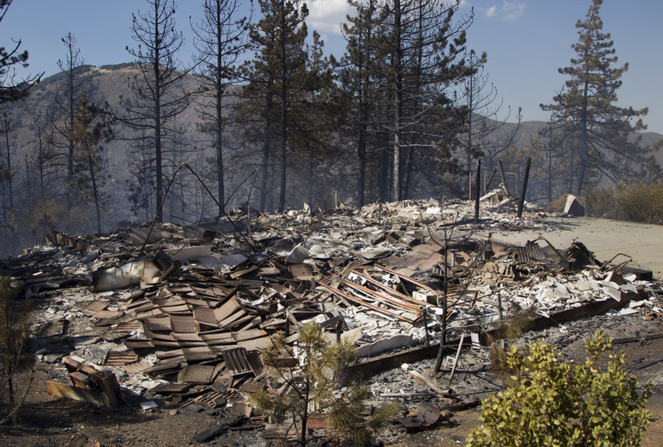 Photo - The foundation is all that is left of a house following a wildfire Thursday, July 3, 2014, in the Julian, Calif., area. (AP Photo/UT San Diego, Sean M. Haffey) TV OUT  NO SALES  MAGS OUT  ARCHIVE OUT  ONLINES OUT