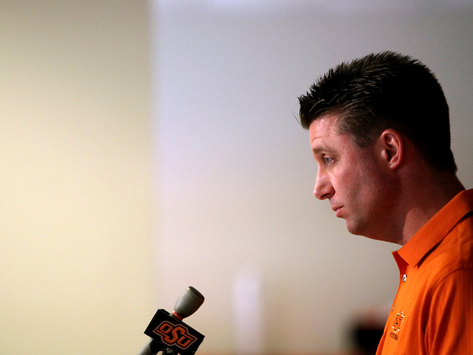 Photo - Oklahoma State head coach Mike Gundy listens to questions from the media during a press conference at Boone Pickens Stadium in Stillwater, Okla., on Wednesday, Feb. 4, 2009. By John Clanton, The Oklahoman