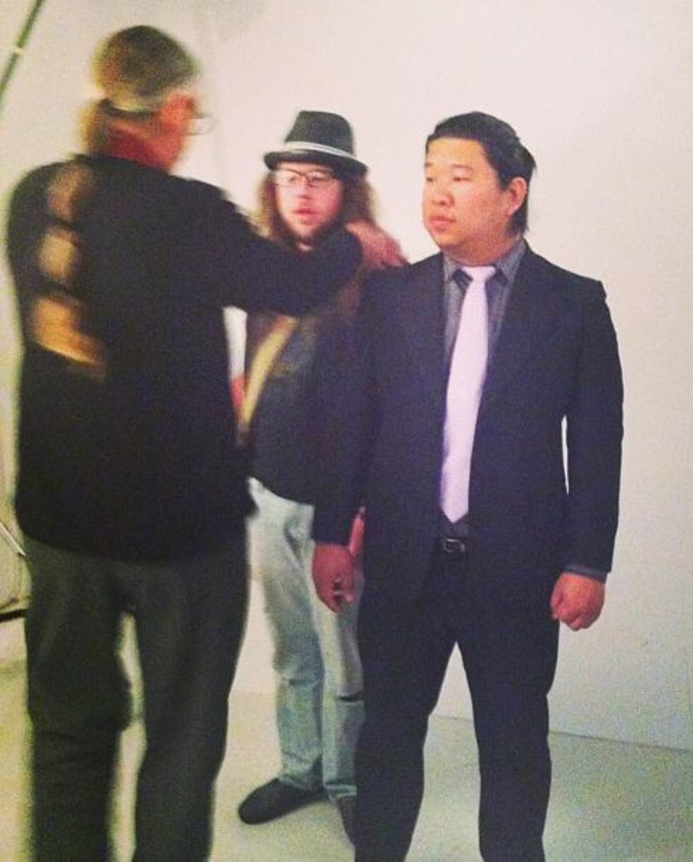 Photo - Right: Doug Hoke tells UCO students Billy Godwin, left and Joshua Lim, right, where to stand for a photo that will appear on an Outlook cover. PHOTOS PROVIDED