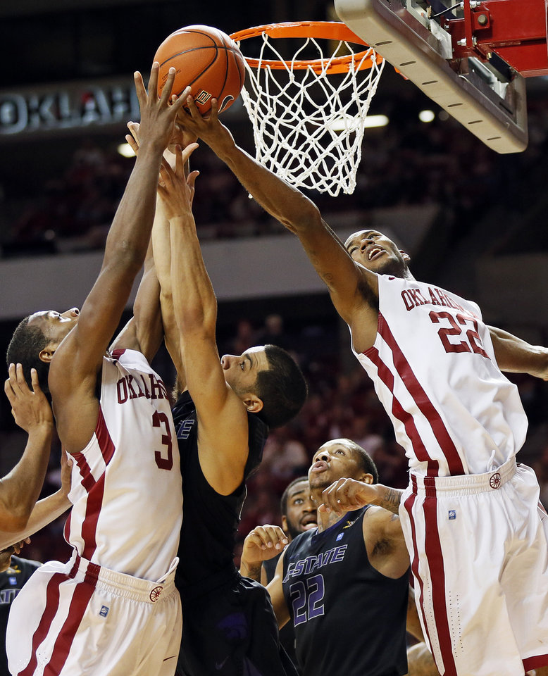 Photo - Oklahoma's Buddy Hield (3) and Amath M'Baye (22) chase a rebound against Kansas State's Angel Rodriguez (13) and Rodney McGruder (22) during an NCAA men's basketball game between the University of Oklahoma (OU) and Kansas State at the Lloyd Noble Center in Norman, Okla., Saturday, Feb. 2, 2013. Kansas State won, 52-50. Photo by Nate Billings, The Oklahoman