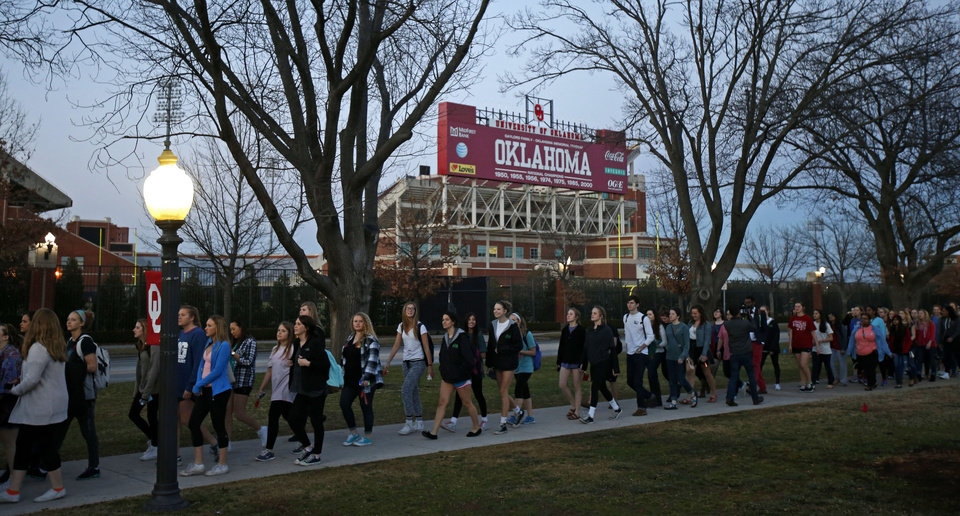 Photo - Students march across the University of Oklahoma Campus to the Sigma Alpha Epsilon fraternity house in Norman, Okla., in reaction to a racist bus incident involving members of the Sigma Alpha Epsilon fraternity on Tuesday, March 10, 2015. Photo by Bryan Terry, The Oklahoman