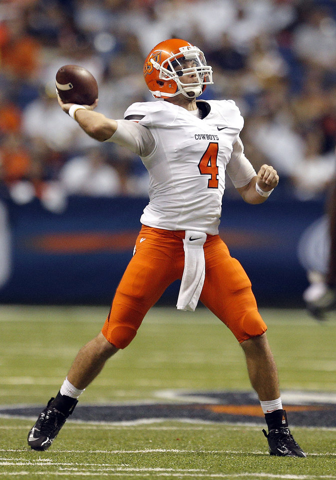 Oklahoma State's J.W. Walsh (4) throws a pass during the first half of a college football game between the University of Texas at San Antonio Roadrunners (UTSA) and the Oklahoma State University Cowboys (OSU) at the Alamodome in San Antonio, Saturday, Sept. 7, 2013.  Photo by Sarah Phipps, The Oklahoman