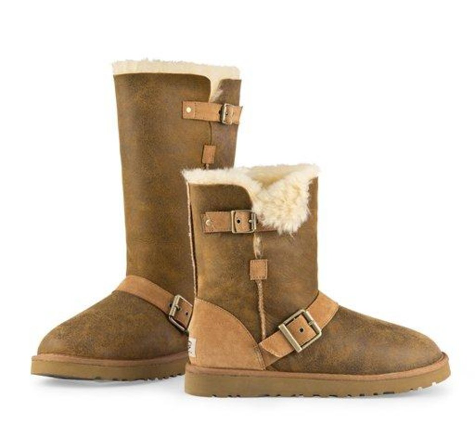 "This undated image provided by Ugg, shows a Dylyn Tall and Short Ugg boot in Chestnut Bomber. A closet full of beautiful boots and gravity-defying heels, flat-foot, furry Uggs weren't at the top of celebrity stylist-designer Rachel Zoe's shopping list. But""Once you put them on, you can't go back,"" Zoe says. ""In my house, it's now the family at-home shoe. I wear them all the time. My son has 10 pairs and my husband has 10 pairs."" (AP Photo/Ugg)"