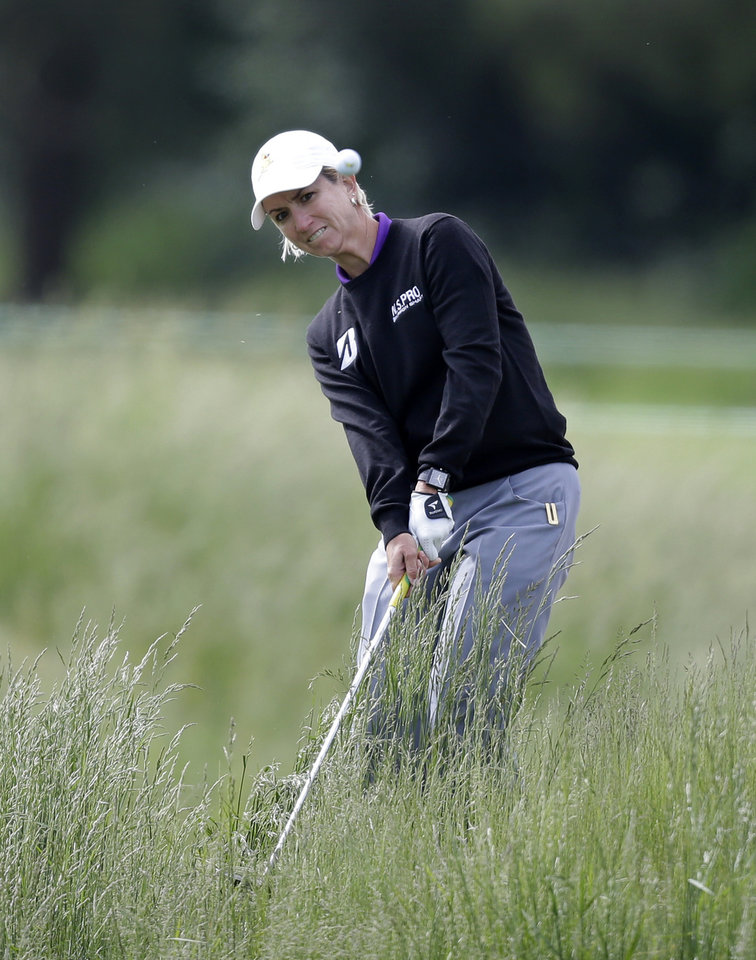 Photo - Karrie Webb, of Australia, hits from fescue grass in the rough on the third hole during the first round of the ShopRite LPGA Classic golf tournament in Galloway Township, N.J., Friday, May 30, 2014. (AP Photo/Mel Evans)