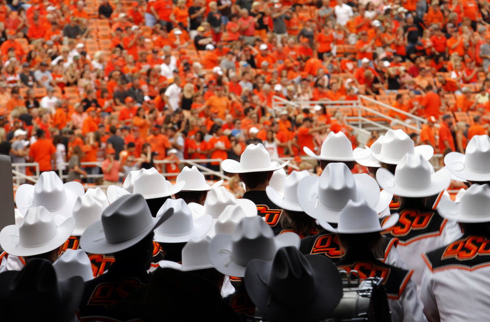 Photo - The Oklahoma State marching band enters the field during a college football game between the Oklahoma State University Cowboys (OSU) and the Lamar University Cardinals at Boone Pickens Stadium in Stillwater, Okla., Saturday, Sept. 14, 2013. Photo by Sarah Phipps, The Oklahoman